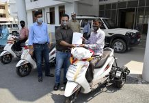 DC Ramban, Nazim Zia Khan giving motorized tricycle to specially abled person on Wednesday.