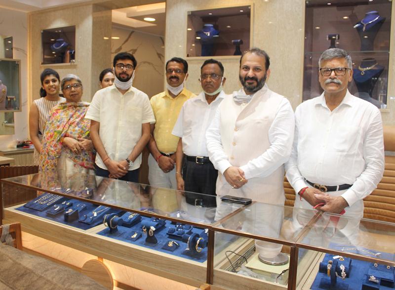 Owner of Phagu Mal Rattan Chand Jain Jewellers posing with senior BJP leader Raman Suri and others in their renovated showroom in Jammu. — Excelsior/Rakesh
