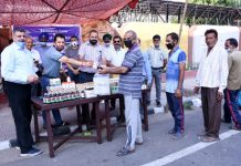 Free AYUSH medicines being distributed during a camp organized at entry gate of Amar Singh Club.
