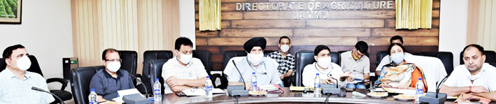 Director Agriculture chairing a meeting on Wednesday.