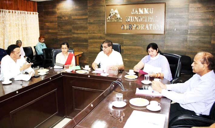JMC Mayor, Chander Mohan Gupta chairing a meeting on Wednesday.