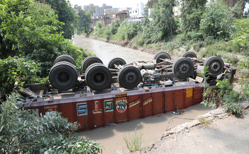 A truck with its upside down lying in Ranbir Canal at Toph Sherkhanian in Jammu.