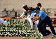 Defence Minister Rajnath Singh, MoS Defence Shripad Naik paying tributes at the National War Memorial on the 21st Kargil Vijay Diwas, in New Delhi on Sunday. (UNI)