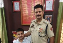 SDPO Akhnoor, Ajay Sharma giving his chair to a meritorious student of Class 12th.