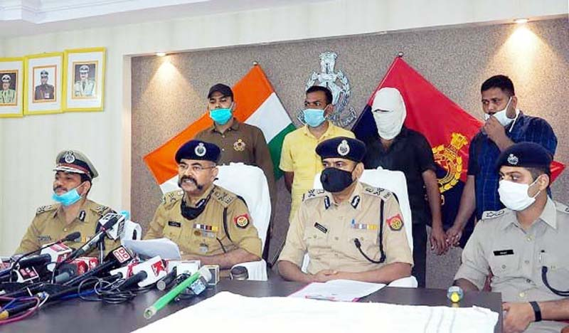 Uttar Pradesh ADG (Law and Order) Prashant Kumar (C) along with other officers adresses a press conference after the arrest of gangster Vikas Dubey's aide Shashikant Pandey, in Kanpur. Pandey is an accused in July 3 Kanpur ambush.