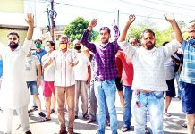 Residents and activists of Young Panthers raising slogans during protest.