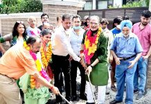 Former Dy CM Kavinder Gupta kick starting blacktopping work of road.