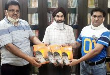Balbir Ram Rattan, spokesman BJP handing over books to incharge Nana Ji Deshmukh Library, Kulbushan Mohtra and BJP senior leader, Virenderjit Singh at Jammu on Monday.