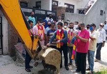 Chairman JMC and senior BJP leader Baldev Singh Billawaria starting construction work of lane and drain.