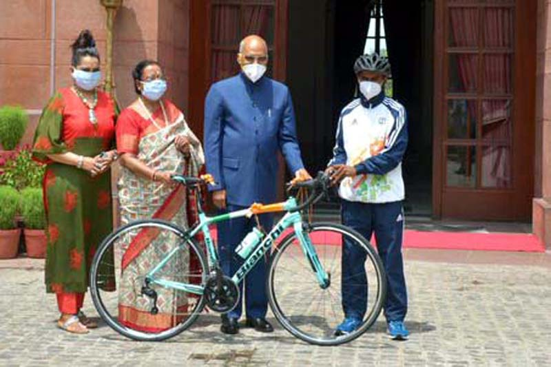 President Kovind gifting cycle to youth on Eid on Friday.