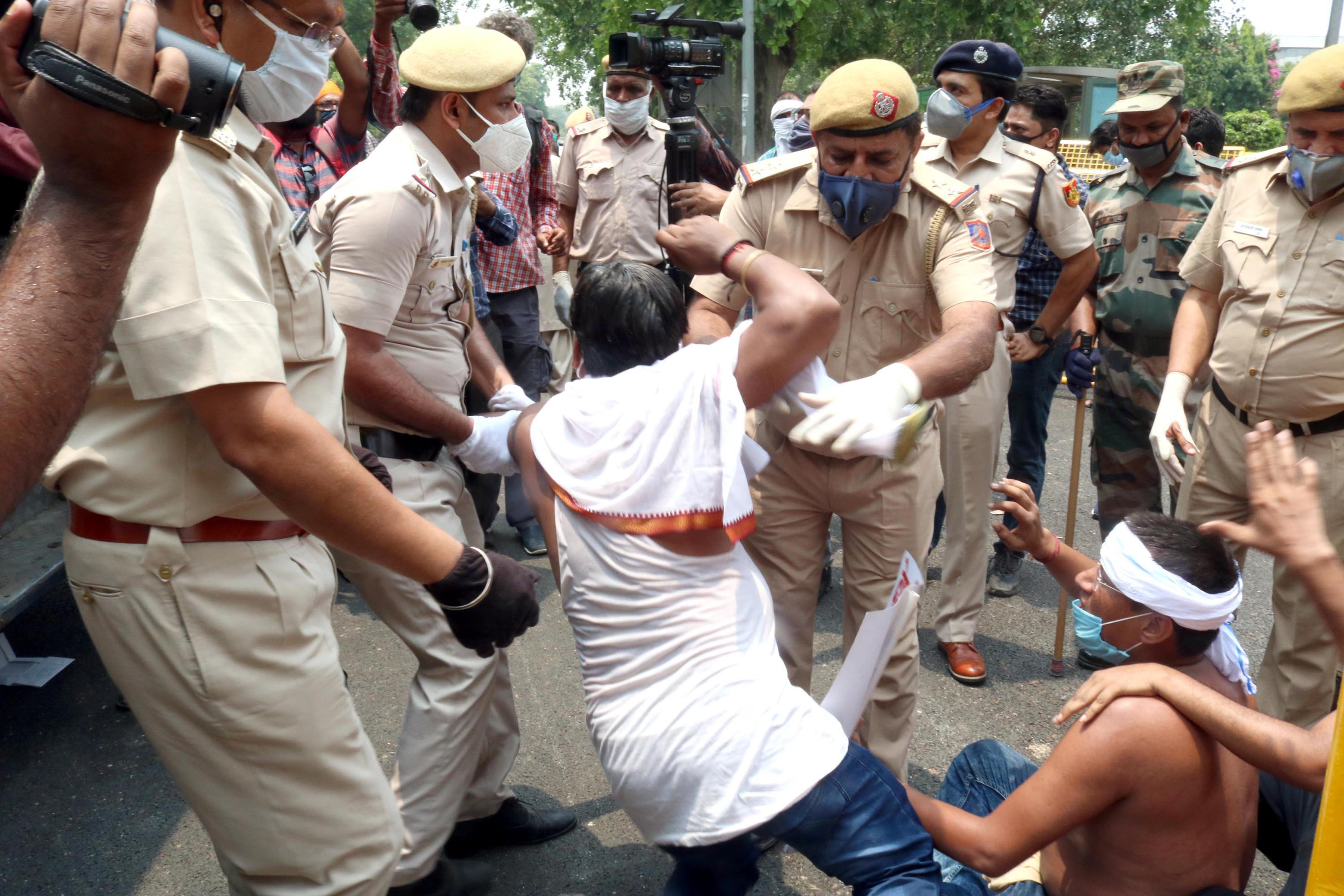Police arresting Youth Congress activists during a demonstration in protest against the privatisation of Indian Railways in New Delhi on Friday. (UNI)