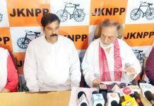 Prof Bhim Singh and Harsh Dev Singh addressing press conference at Jammu on Sunday.