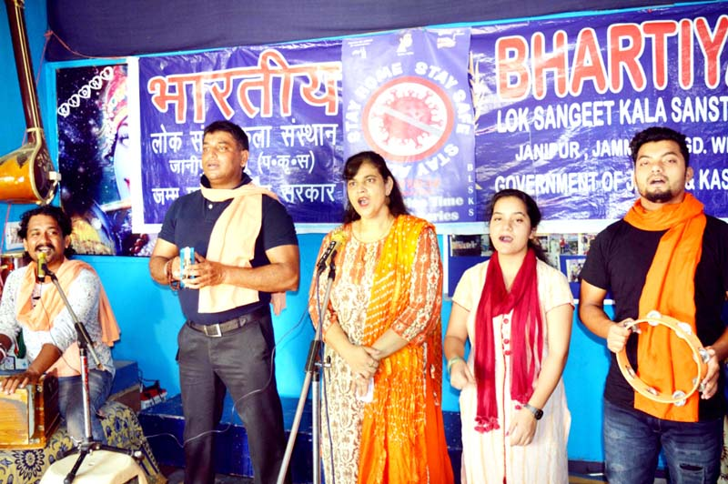 Artists presenting song during 'World Breast Feeding Week' celebration.