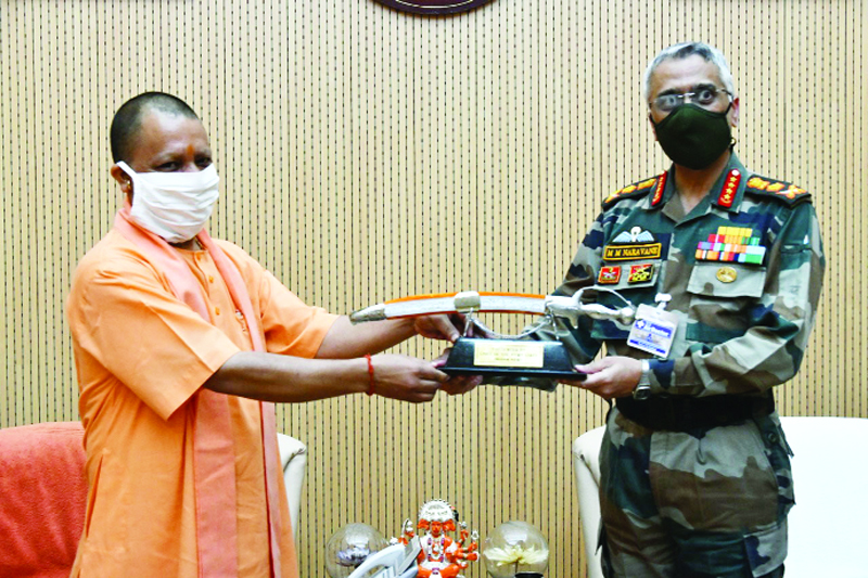 Army Chief General Manoj Mukund Naravane meeting Uttar Pradesh Chief Minister Yogi Aditiyanath in Lucknow on Friday. (UNI)