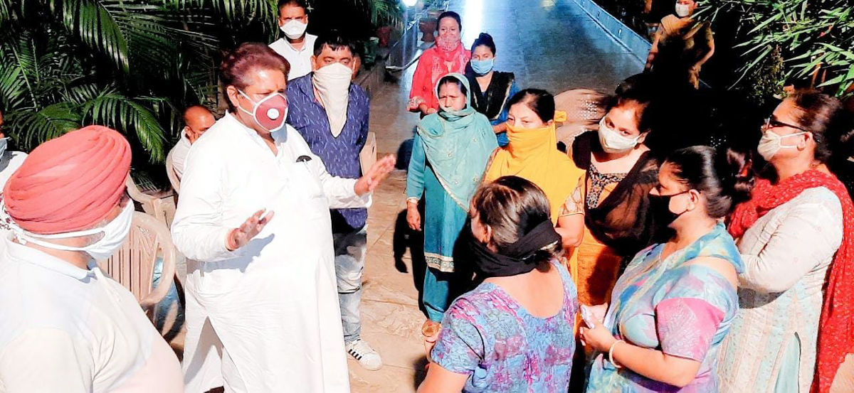 Cong leader Raman Bhalla interacting with people in Gandhi Nagar area on Sunday.
