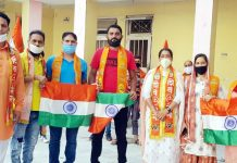 Leaders of Shiv Sena Bala Sahib Thackeray J&K Unit distributing National Flag at Katra on Sunday.
