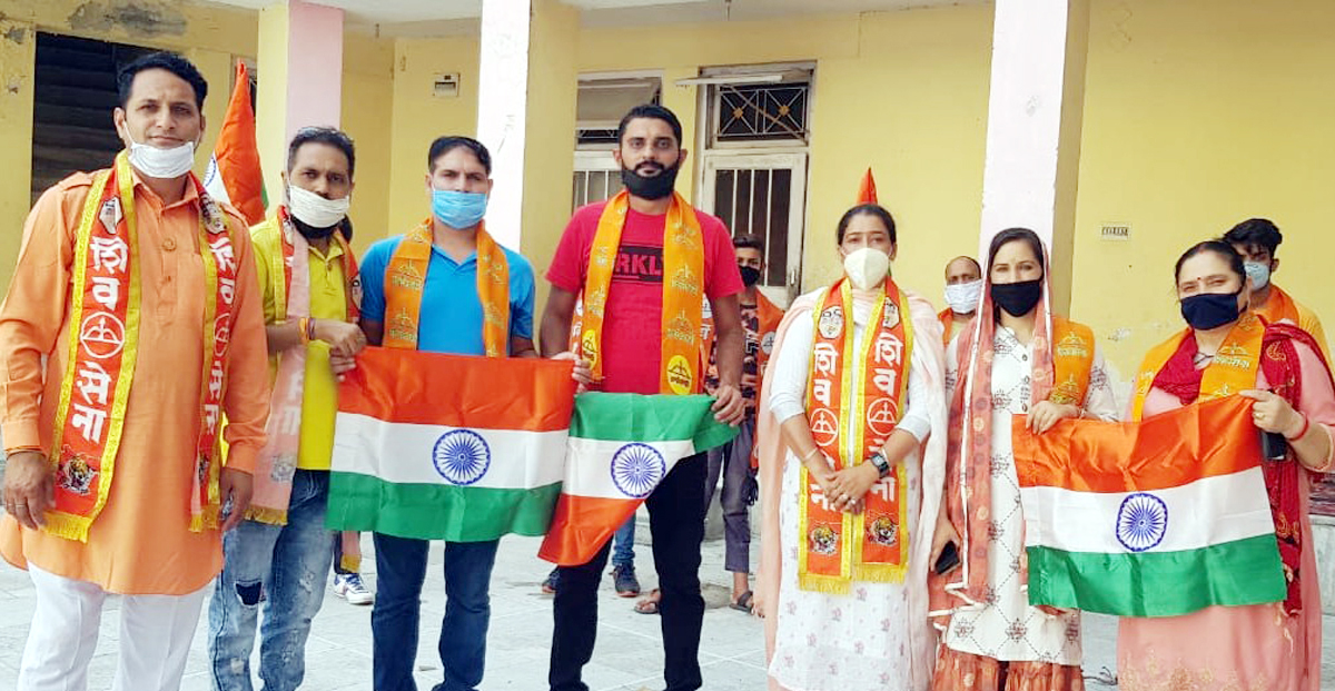 Leaders of Shiv Sena Bala Sahib Thackeray J&K Unit distributing National Flag at Katra on Sunday.