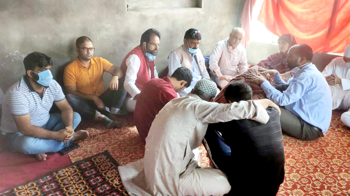 BJP leaders consoling the family members of Sarpanch, Sajad Ahmed Khanday at his Qazigund residence on Saturday.