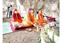 Sadhus performing Puja at holy cave of Shri Amarnath Ji on Monday.