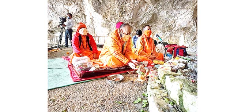 Sadhus performing Puja at holy cave of Shri Amarnath Ji on Monday.