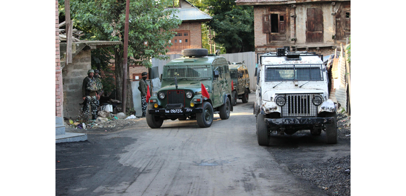 Security personnel at the site of encounter in Shopian on Friday.