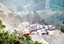 Vehicles stranded on highway at Ramban after landslides on Thursday. -Excelsior/Parvez Mir