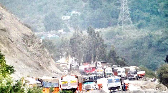 Vehicles stranded on highway at Ramban after landslides on Thursday. -Excelsior/Parvez Mir