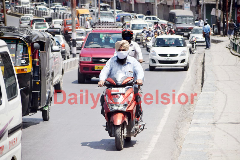Traffic moves on roads as curbs were eased in Srinagar on Thursday. -Excelsior/Shakeel
