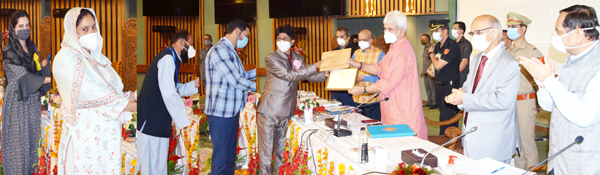 Lieutenant Governor Manoj Sinha felicitating national level awardee Sarpanchs, ULB representatives & COVID warriors in Srinagar on Wednesday.