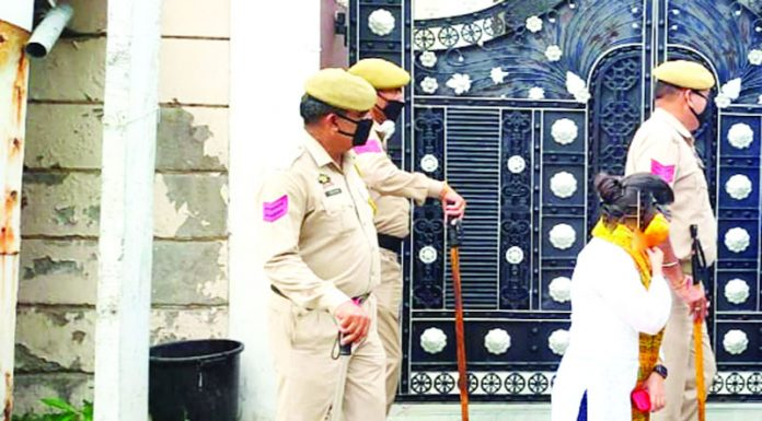 Cops outside Trikuta Nagar residence of Hilal Rather during ED raids on Thursday.