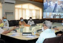 Chief Secretary BVR Subrahmanyam reviewing COVID management in Srinagar on Tuesday.