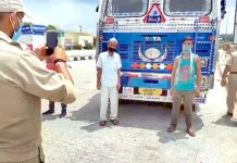 A truck undergoing security check at Lakhanpur on Sunday. -Excelsior/Madan