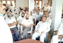Former minister, Dr Manohar Lal Sharma addressing Block Congress Committee meeting in Kathua.
