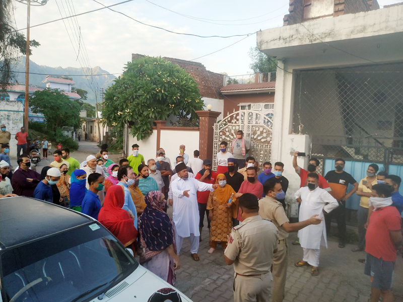 Residents protesting for lifting restrictions in their locality.