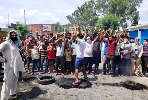 Locals of Devipur Panchayat during a protest demonstration on Friday.