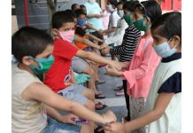 Girls in Bal Ashram Jammu tying Rakhi to boys on the occasion of Rakshabandhan on Monday. —Excelsior/Rakesh