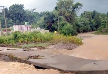 Bridge washed away in flash floods at Badwana village in Samba district on Saturday. -Excelsior/Badyal