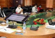Advisor K K Sharma chairing a meeting on Monday.