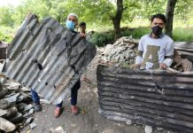 Residents show tin sheets damaged in shelling in Bhag Bella village in Tangdhar area of north Kashmir. —Excelsior/Aabid Nabi