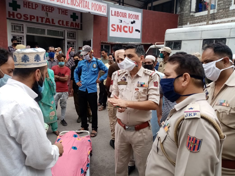 Police pacifying protesting relatives after woman dies of negligence in Poonch hospital. —Excelsior/Gurjeet