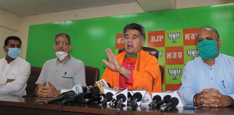 BJP leaders addressing a press conference at Jammu on Thursday.