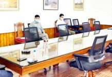 LG GC Murmu chairing a meeting on Tuesday.