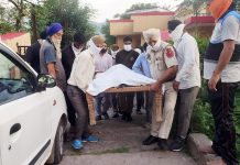 Dead body of murdered man being taken to village from Poonch Hospital. — Excelsior/Gurjeet
