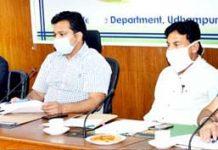 DDC Piyush Singla chairing a meeting at Udhampur.