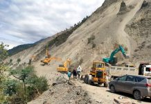 Machines engaged for highway clearance work near Ramban on Friday. -Excelsior/Parvaiz Mir