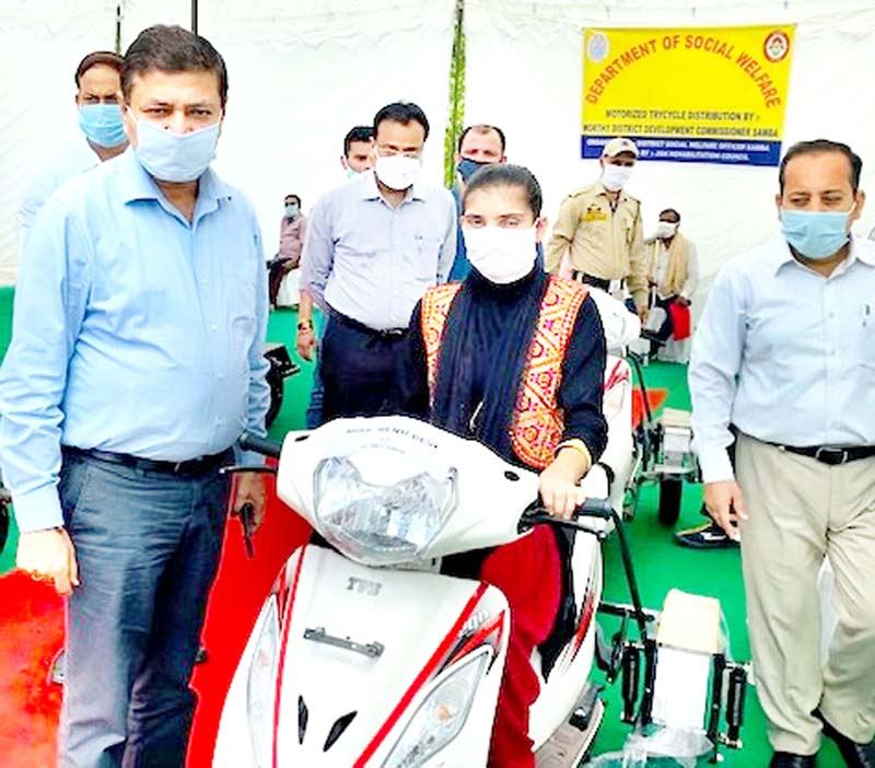 DC Samba Rohit Khajuria handing over scooty to specially-abled person on Thursday.