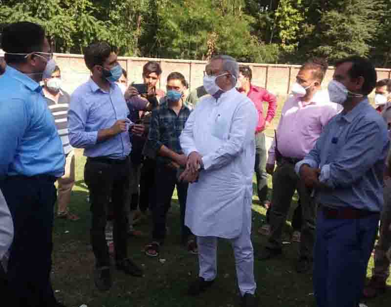 Advisor Farooq Khan interacting with officials on Wednesday.