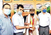 A centenarian freedom fighter being honoured by administration.