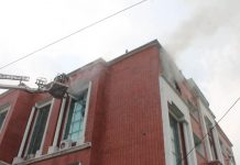 Fire fighter engaged in dousing flames. -Excelsior/Rakesh