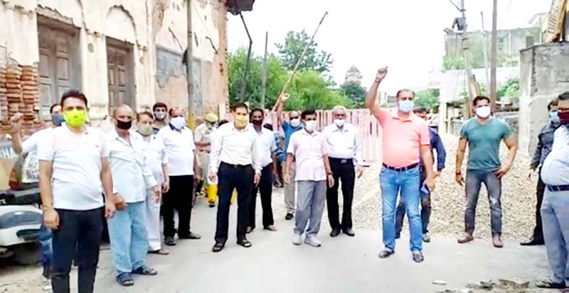 Residents raising slogans during protest.
